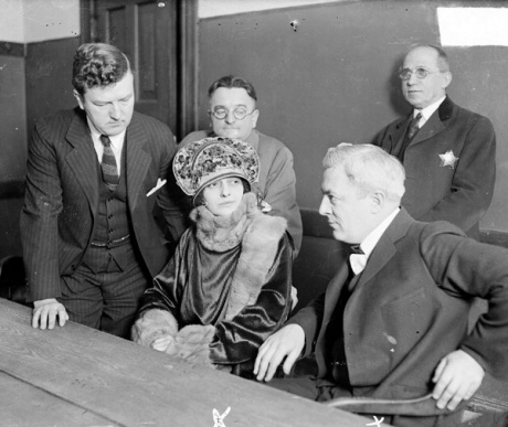 Belva Gaertner sitting at a table and looking at her defense attorney, Thomas D. Nash.  (c) Chicago History Museum.